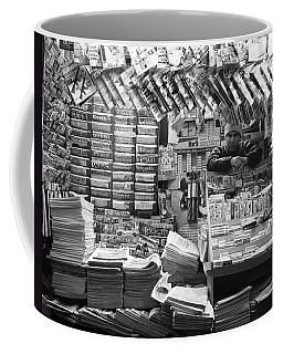 Coffee Mug featuring the photograph Newsstand And Vendor by Dave Beckerman