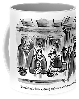 One Man Talks To Another At A Table In What Coffee Mug
