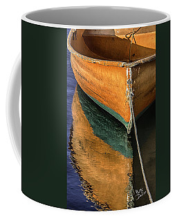 Coffee Mug featuring the photograph Orange Dinghy In Warm Sun by Betty Denise