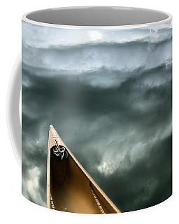 Paddling Before The Storm Coffee Mug