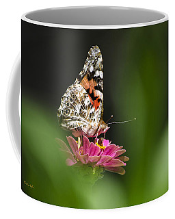 Coffee Mug featuring the photograph Painted Lady Butterfly At Rest by Christina Rollo