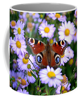 Peacock Butterfly Perched On The Daisies Coffee Mug