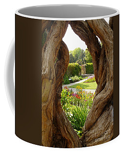 Coffee Mug featuring the photograph Peek At The Garden by Vicki Spindler
