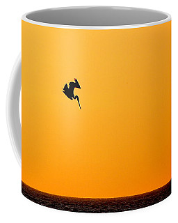 Pelican Diving At Sunset Coffee Mug by AJ  Schibig