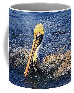 Showering Pelican Coffee Mug by Larry Nieland