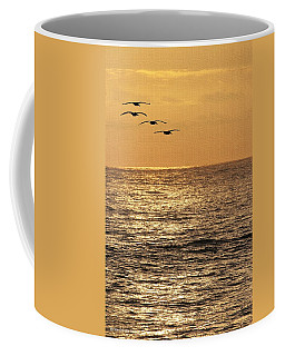 Pelicans Ocean And Sunsetting Coffee Mug by Tom Janca