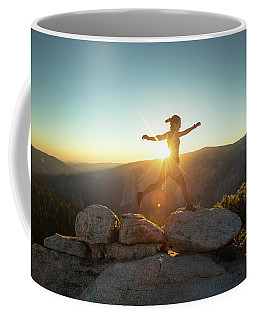 Person Leaping Along Rocks At Sunset Coffee Mug