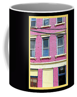 Coffee Mug featuring the photograph Pink Yellow Blue Building by Kathy Barney