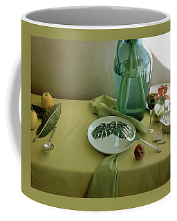 Plates, Apples And A Vase On A Green Tablecloth Coffee Mug