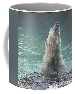 Polar Bear Jumping Out Of The Water Coffee Mug by John Telfer