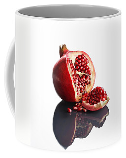 Pomegranate Opened Up On Reflective Surface Coffee Mug