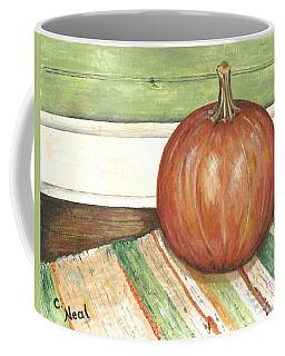 Pumpkin On A Rag Rug Coffee Mug