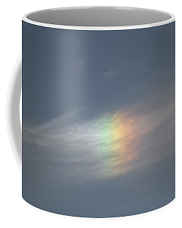 Coffee Mug featuring the photograph Rainbow In The Clouds by Eti Reid