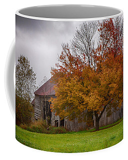Coffee Mug featuring the photograph Rainbow Of Color In Front Of Nh Barn by Jeff Folger