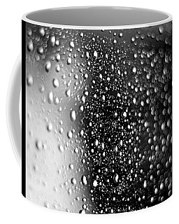 Coffee Mug featuring the photograph Raindrops by Viviana  Nadowski