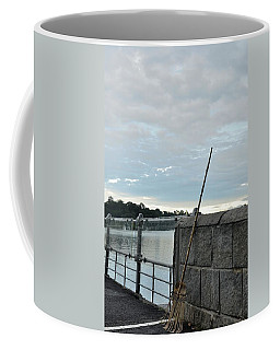Coffee Mug featuring the photograph Rake Rests Itself After A Hard Days Work by Imran Ahmed