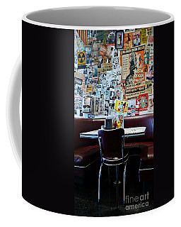 Red Booth Awaits In The Diner Coffee Mug by Nina Prommer