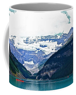Red Canoes Turquoise Water Coffee Mug by Linda Bianic