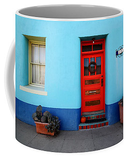 Red Door On Blue Wall Coffee Mug
