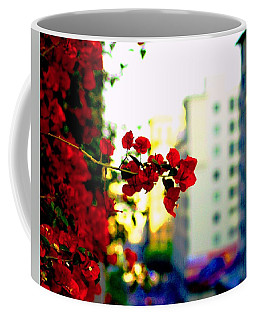 Coffee Mug featuring the photograph Red Flowers Downtown by Matt Harang