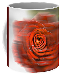 Coffee Mug featuring the photograph Red Rose by Leif Sohlman