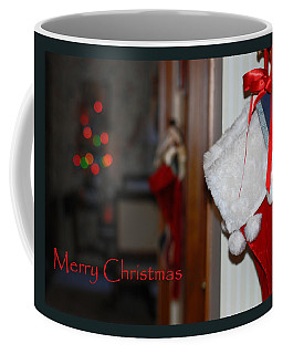 Coffee Mug featuring the photograph Red Stockings Say Merry Christmas by Connie Fox