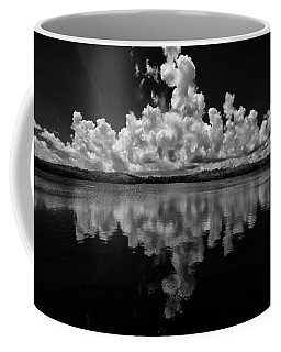 Reflection Of Clouds Coffee Mug