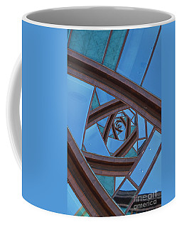 Coffee Mug featuring the photograph Revolving Blues. by Clare Bambers