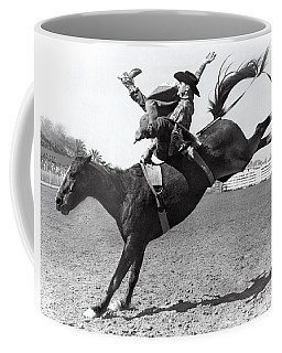 Riding A Bucking Bronco Coffee Mug
