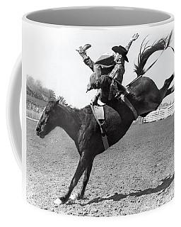 Riding A Bucking Bronco Coffee Mug