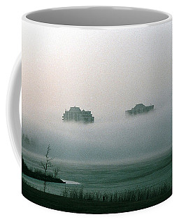 Coffee Mug featuring the photograph Rising From The Mist by David Porteus