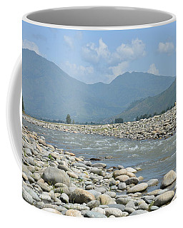 Riverbank Water Rocks Mountains And A Horseman Swat Valley Pakistan Coffee Mug
