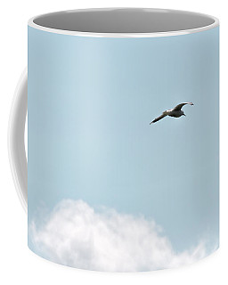 Coffee Mug featuring the photograph Seagull Flying High by Leif Sohlman