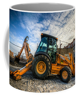 Side View Of A Backhoe At Sunset Coffee Mug