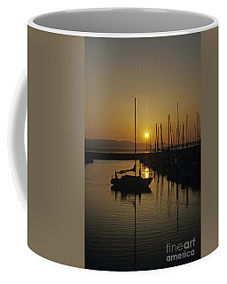 Silhouetted Man On Sailboat Coffee Mug