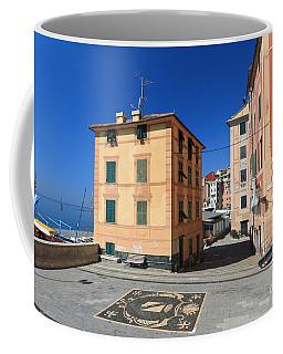 Coffee Mug featuring the photograph small square in Sori by Antonio Scarpi