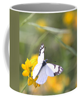 Coffee Mug featuring the photograph Small White Butterfly On Yellow Flower by Belinda Greb