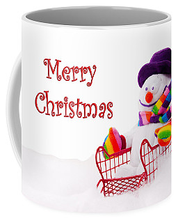 Coffee Mug featuring the photograph Snowman Riding In A Red Sleigh - Christmas  by Vizual Studio