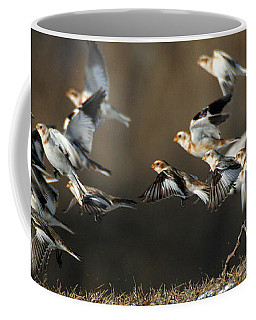 Snow Buntings Taking Flight Coffee Mug