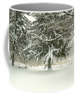 Coffee Mug featuring the photograph Snow-covered Trees by Lars Lentz