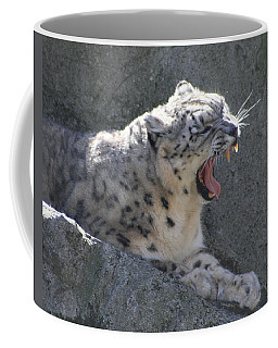 Snow Leopard Yawn Coffee Mug by Neal Eslinger