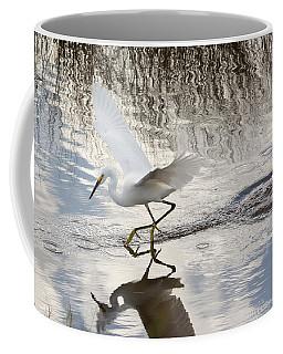 Snowy Egret Gliding Across The Water Coffee Mug