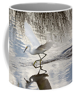 Snowy Egret Gliding Across The Water Coffee Mug by John M Bailey
