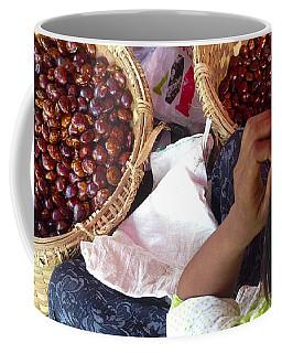 Coffee Mug featuring the photograph Sorting Water Chestnuts Zay Cho Street Market 29th Street Mandalay Burma by Ralph A  Ledergerber-Photography