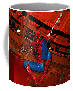 Spiderman Swinging Through The Air Coffee Mug by John Telfer