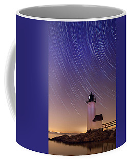 Coffee Mug featuring the photograph Stars Trailing Over Lighthouse by Jeff Folger