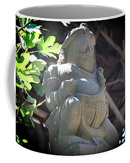 Statue In The Sun Coffee Mug
