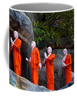 Statues Of The Buddhist Monks At Golden Temple Coffee Mug