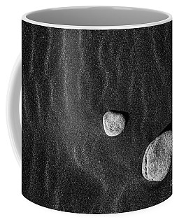 Coffee Mug featuring the photograph Stones In The Sand by Gunnar Orn Arnason