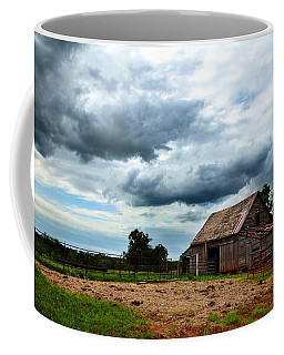Storms Loom Over Barn On The Prairie Coffee Mug